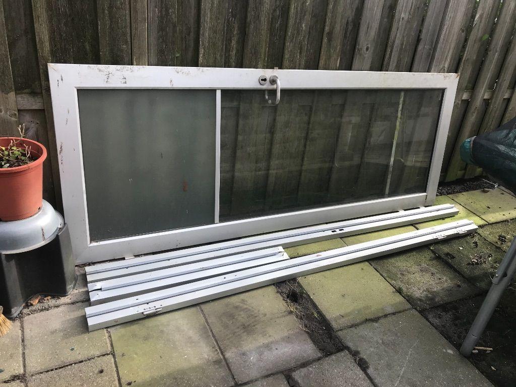 Grote Alu deur met kozijn 245 x 92cm