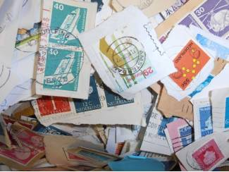 Postzegels onafgeweekt