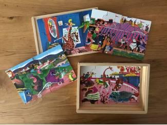 Vier kleine puzzels in houten doosje