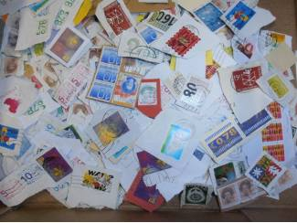 Postzegels onafgeweekt Nederland € 10,-- per kg  AKTIE!